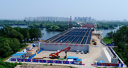 July 18, 2017 - Shenyan, Shenyan, China - Shenyang, CHINA-July 18 2017: (EDITORIAL USE ONLY. CHINA OUT) ..The 'floating' bridge without pillars is under construction in Shenyang, northeast China's Liaoning Province, July 18th,2017. The bridge will be completed before November 30th, 2017. (Credit Image: © SIPA Asia via ZUMA Wire)