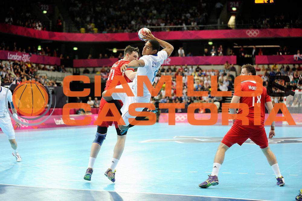 DESCRIZIONE : France Hand Jeux Olympiques Londres <br /> GIOCATORE : Narcisse Daniel FRA<br /> SQUADRA : France Homme<br /> EVENTO : FRANCE Hand Jeux Olympiques<br /> GARA : FRANCE GRANDE BRETAGNE<br /> DATA : 29 07 2012<br /> CATEGORIA : Basketball Jeux Olympiques<br /> SPORT : Basketball<br /> AUTORE : JF Molliere <br /> Galleria : France Basket 2011-2012 Action<br /> Fotonotizia : France Basket Homme Jeux Olympiques Londres premier tour France Grande Bretagne<br /> Predefinita :