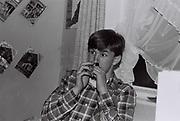 Boy sniffing amyl nitrate, London, UK, 1984