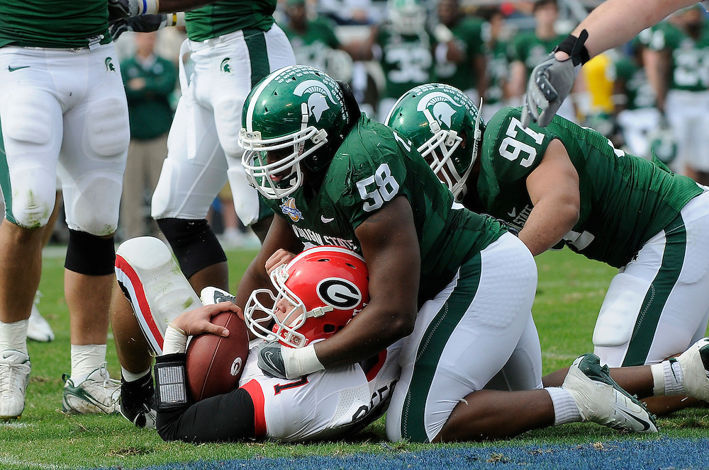 January 1, 2009: Matthew Stafford of the Georgia Bulldogs is tackled by Trevor Anderson of the Michigan State Spartans during the NCAA football game between the Michigan State Spartans and the Georgia Bulldogs in the Capital One Bowl. The Spartans were leading the Bulldogs 6-3 at halftime.