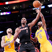 13 January 2014: Miami Heat center Chris Bosh (1) grabs the rebound over Los Angeles Lakers guard Ronnie Price (9) and Los Angeles Lakers forward Carlos Boozer (5) during the Miami Heat 78-75 victory over the Los Angeles Lakers, at the Staples Center, Los Angeles, California, USA.