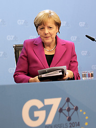 © Licensed to London News Pictures. 04/06/2014. BRUSSELS, BELGIUM.<br /> ANGELA MERKEL, GERMAN CHANCELLOR, GIVES A PRESS CONFERENCE AT THE G7 SUMMIT IN BRUSSELS THIS EVENING AFTER THE WORKING DINNER WITH G7 LEADERS. Photo credit : RICH BOWEN/LNP