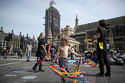 © Licensed to London News Pictures. 18/04/2019. London, UK. Protesters from Extinction Rebellion take part in activities including dance and music outside the Houses Of Parliament, as they occupy Parliament Square for a fourth day. Protesters are demanding urgent government action on climate change. Photo credit: Ben Cawthra/LNP