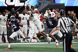 UCF Knights wide receiver Tre'Quan Smith (4) makes a catch during the 2018 Chick-fil-A Peach Bowl NCAA football game against the Auburn Tigers on Monday, January 1, 2018 in Atlanta. (Jason Parkhurst / Abell Images for the Chick-fil-A Peach Bowl)