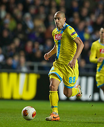 SWANSEA, WALES - Thursday, February 20, 2014: SSC Napoli's Gokhan Inler in action against Swansea City during the UEFA Europa League Round of 32 1st Leg match at the Liberty Stadium. (Pic by David Rawcliffe/Propaganda)