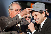 27 DECEMBER 2008 -- PHOENIX, AZ: Congressman Ed Pastor (LEFT) put an engineer's cap on Mayor Phil Gordon at the opening of the downtown light rail station. Metro Light Rail started running Saturday, Dec. 28. The light rail line is 20 miles long and cost $1.4 billion dollars. PHOTO BY JACK KURTZ
