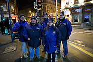 Dr Patrick Halls, Alasdair Kay, James and Amanda Anderson and John Jameson, members of the the Derby Street Pastor team on patrol in Derby city centre. Street Pastor was pioneered in London in January 2003 and Derby Street Pastors is a partnership of 25 local churches, Derbyshire Police, local council and various groups concerned with city centre street business and safety. Each Street Pastor team member works a minimum of one night a month, usually from 10pm to around 4am.