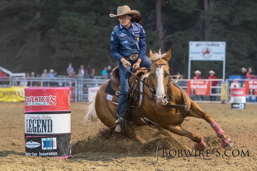 Ivy Conrado makes her run in the barrel racing during the second performance of the Elizabeth Stampede on Saturday, June 2, 2018.