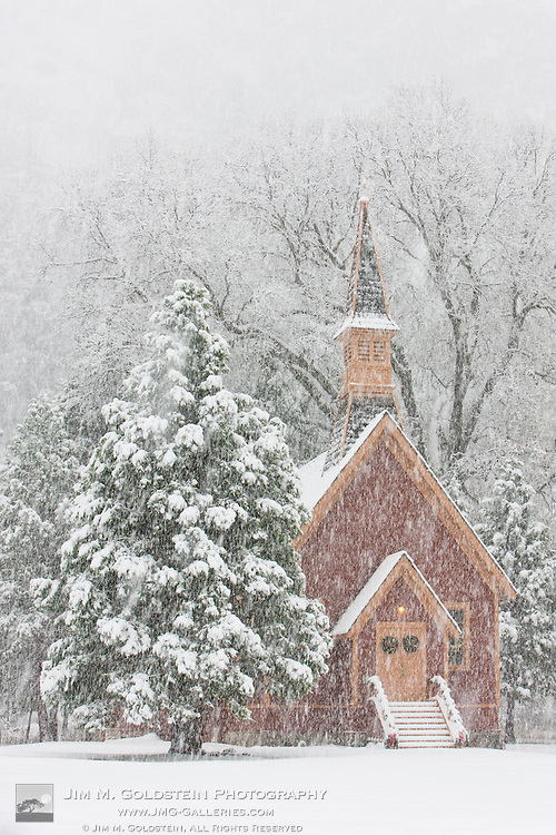 Yosemite Valley Chapel adorned in Christmas decorations during a snow storm - Yosemite National Park, California
