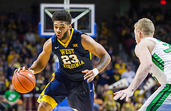 Dec 17, 2015; Charleston, WV, USA; West Virginia Mountaineers forward Esa Ahmad (23) drives down the lane during the first half against the Marshall Thundering Herd at the Charleston Civic Center . Mandatory Credit: Ben Queen-USA TODAY Sports