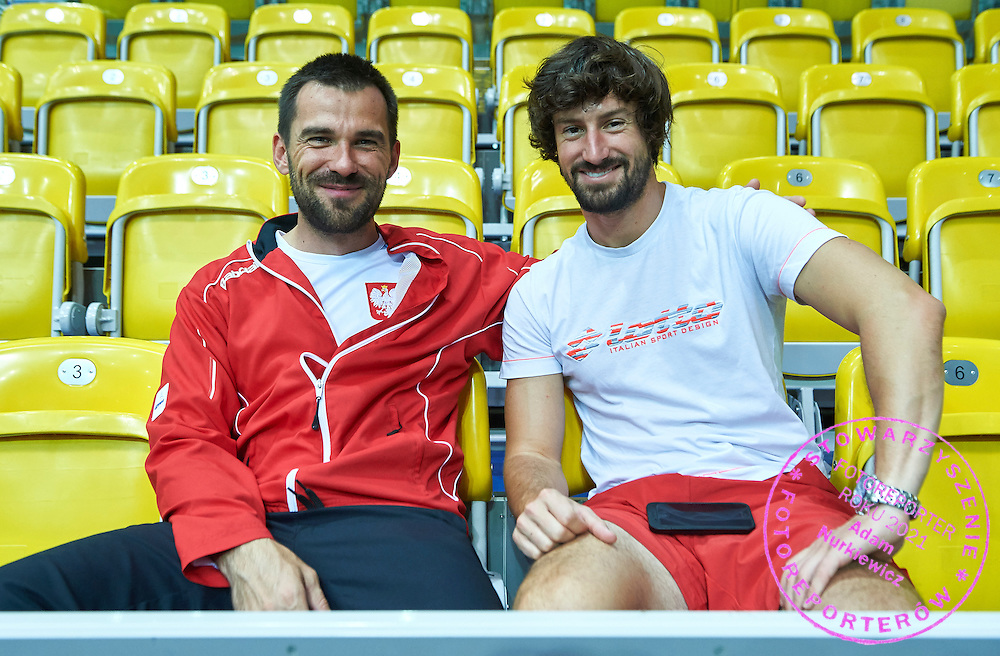 (L) pshychologist Pawel Habrat and (R) physiotherapist Krzysztof Guzowski sit on the tribune during Davis Cup Tie World Group Play-off Poland v Slovakia at Gdynia Arena Hall in Gdynia, Poland.<br /> <br /> Poland, Gdynia, September 18, 2015<br /> <br /> Picture also available in RAW (NEF) or TIFF format on special request.<br /> <br /> For editorial use only. Any commercial or promotional use requires permission.<br /> <br /> Adam Nurkiewicz declares that he has no rights to the image of people at the photographs of his authorship.<br /> <br /> Mandatory credit:<br /> Photo by &copy; Adam Nurkiewicz / Mediasport