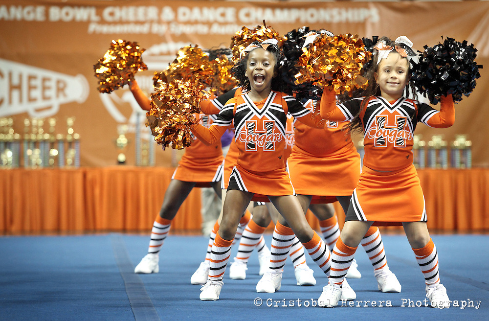 (CH) fl-cheerleading-competition-CHc--Members of the Hialeah Cougars team performers during the 2012 Orange Bowl Youth Football Alliance Cheer and Dance Championships at Bank United Center UM Campus on Sunday November 25, 2012. More than 1,500 cheerleaders and dance teams was compete in the 13th annual Orange Bowl championships. Staff photo/Cristobal Herrera Hialeah News