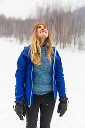 A woman enjoys the outdoos while winter camping in New Hampshire's White Mountains.
