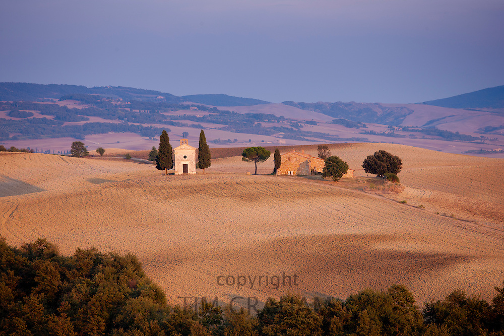 Chapel, Chiesetta di Vitaleta, and typical Tuscan homestead at San Quirico D'Orcia near Pienza  in Val D'Orcia, Tuscany, Italy RESERVED USE - NOT FOR DOWNLOAD - FOR USE CONTACT TIM GRAHAM