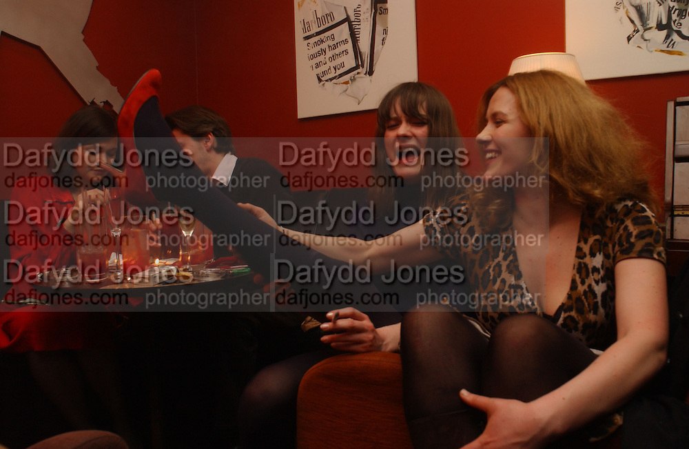 Jasmine guinness, ( background) Iris Palmer and Cynnie Rainey wearing Cynnie Rainey shoes, DAZED AND CONFUSED GAP RED PARTY, Groucho Club, Dean st. London. 15 March 2006. ONE TIME USE ONLY - DO NOT ARCHIVE  © Copyright Photograph by Dafydd Jones 66 Stockwell Park Rd. London SW9 0DA Tel 020 7733 0108 www.dafjones.com