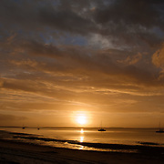 Frazer Island, on the east coast of Australia, is a sand island. Sailship anchorage during Sunset seen from the jetty of Kingfisher Bay Resort.