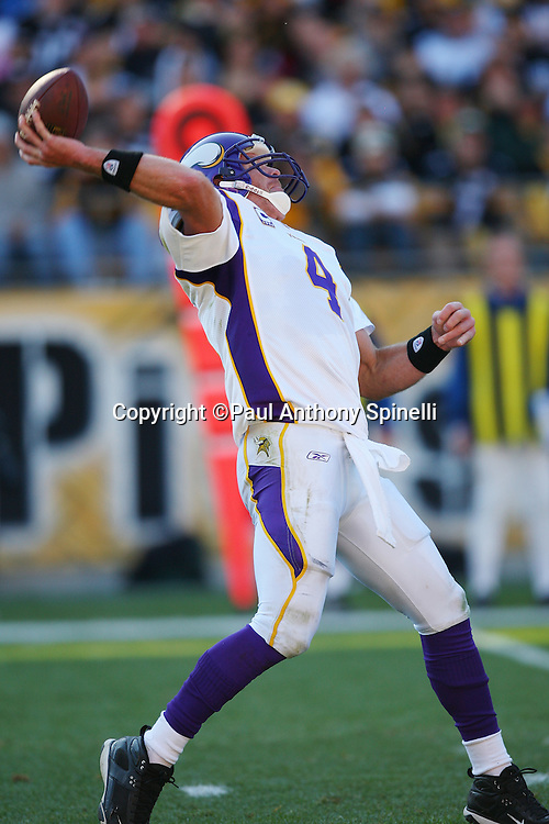 Minnesota Vikings quarterback Brett Favre (4) bends back as he throws a deep pass during the NFL football game against the Pittsburgh Steelers, October 25, 2009 in Pittsburgh, Pennsylvania. The Steelers won the game 27-17. (©Paul Anthony Spinelli)