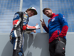 October 26, 2018 - Melbourne, Victoria, Australia - Italian rider Marco Bezzecchi (#12) of Redox PruestelGP at the pit wall with a member of his team during day 2 of the 2018 Australian MotoGP held at Phillip Island, Australia. (Credit Image: © Theo Karanikos/ZUMA Wire)