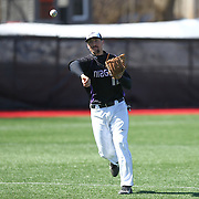 Greg Rodgers #12 of the Niagara Purple Eagles throws the ball during the game at Friedman Diamond on March 16, 2014 in Brookline, Massachusetts. (Photo by Elan Kawesch)