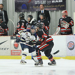 """FORT FRANCES, ON - Apr 30, 2015 : Central Canadian Junior """"A"""" Championship, game action between the Soo Thunderbirds and the Toronto Patriots game five of the Dudley Hewitt Cup. Jacob Hayhurst #12 of the Toronto Patriots pursues the play in the first period.<br /> (Photo by Tim Bates / OJHL Images)"""