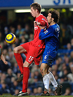 Photo: Daniel Hambury.<br />Chelsea v Liverpool. The Barclays Premiership. 05/02/2006.<br />Chelsea's Ricardo Carvalho and Liverpool's Peter Crouch battle for the ball.