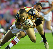 Wigan - Sunday 20th September 2009: Richard Owen of the Castleford Tigers is tackled by George Carmont of the Wigan Warriors during the Engage Super League Elimination Playoff match between The Wigan Warriors & The Castleford Tigers at the DW Stadium in Wigan. (Pic by Steven Price/Focus Images)
