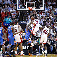 16 March 2011: Miami Heat shooting guard Dwyane Wade (3) dunks the ball over Oklahoma City Thunder center Kendrick Perkins (5) during the Oklahoma City Thunder 96-85 victory over the Miami Heat at the AmericanAirlines Arena, Miami, Florida, USA.