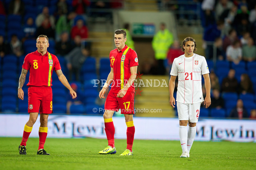CARDIFF, WALES - Tuesday, September 10, 2013: Wales' Gareth Bale and Craig Bellamy in action against Serbia during the 2014 FIFA World Cup Brazil Qualifying Group A match at the Cardiff CIty Stadium. (Pic by David Rawcliffe/Propaganda)