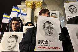 December 17, 2018 - Kiev, Ukraine - Ukrainians hold placards with portraits of Ukrainians who are arrested in Russia, during a rally in support of Ukrainian navy sailors which were seized by Russia during the Kerch Strait incident on 25 November, and in support other Ukrainian political prisoners jailed in Russia, on the Independence Square in Kiev, Ukraine, 17 December, 2018. Tensions between Ukraine and Russia rose on 25 November, when Russian forces seized three Ukranian navy vessels with Ukrainian navy sailors. Ukrainian Parliament voted on 26 November for accepting of the state of martial law in regions close to the Black and Azov seas and along of the border with Russia for a period 30 days. (Credit Image: © Str/NurPhoto via ZUMA Press)