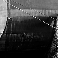 MIRAFLORES LOCKS - PANAMA CANAL<br /> Photography by Aaron Sosa<br /> Panama City, Panama 2012<br /> (Copyright © Aaron Sosa)<br /> <br /> Detail of a European ship passing through the Panama Canal.<br /> <br /> The Panama Canal is an 77.1-kilometre (48 mi) ship canal in Panama that connects the Atlantic Ocean (via the Caribbean Sea) to the Pacific Ocean. The canal cuts across the Isthmus of Panama and is a key conduit for international maritime trade. There are locks at each end to lift ships up to Lake Gatun (26m (85ft) above sea-level) which was used to reduce the amount of work required for a sea-level connection. The current locks are 33.5m (110ft) wide although new larger ones are proposed.<br /> <br /> Work on the canal, which began in 1881, was completed in 1914, making it no longer necessary for ships to sail the lengthy Cape Horn route around the southernmost tip of South America (via the Drake Passage) or to navigate the dangerous waters of the Strait of Magellan. One of the largest and most difficult engineering projects ever undertaken, the Panama Canal shortcut made it possible for ships to travel between the Atlantic and Pacific Oceans in half the time previously required. The shorter, faster, safer route to the U.S. West Coast and to nations in and along the Pacific Ocean allowed those places to become more integrated with the world economy.