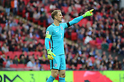 Joe Hart of England pointing during the FIFA World Cup Qualifier group stage match between England and Lithuania at Wembley Stadium, London, England on 26 March 2017. Photo by Matthew Redman.