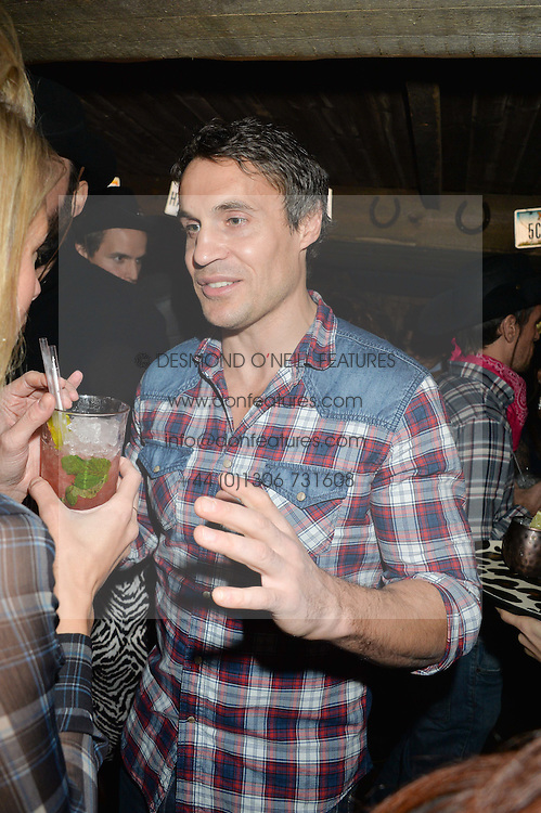 ADAM BIDWELL at a party to celebrate the opening of Beaver Lodge, a new bar & club from the Inception Group at 266 Fulham Road, London SW10 on 4th December 2014.
