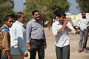 Shantilal talking to farmers at the ginners with his cotton in Madhya Pradesh, India.