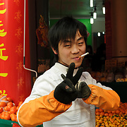 Fruit seller in a market, Shanghai, China, Asia