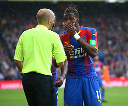 September 22, 2018 - London, England, United Kingdom - Crystal Palace's Wilfried Zaha having words with Linesman.during Premier League between Crystal Palace and Newcastle United  at Selhurst Park Stadium , London , England on 22 Sept 2018. (Credit Image: © Action Foto Sport/NurPhoto/ZUMA Press)