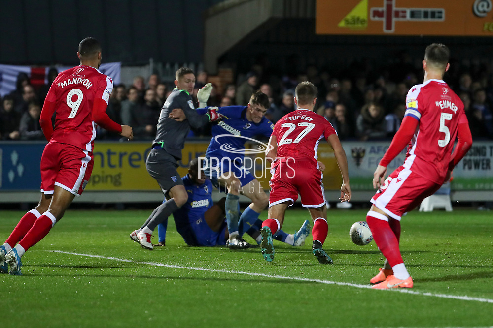 Gillingham defender Jack Tucker (27) about to clear a scramble in the box during the EFL Sky Bet League 1 match between AFC Wimbledon and Gillingham at the Cherry Red Records Stadium, Kingston, England on 23 November 2019.