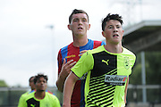 Connor Dymond awaits the incomming cross during the U21 Professional Development League match between Crystal Palace U21s and Huddersfield U21s at Imperial Fields, Tooting, United Kingdom on 7 September 2015. Photo by Michael Hulf.