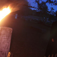 By torchlight, an Aberdeen High School student tells the story of one of the town's early residents buried at the Old Aberdeen Cemetery during the Lies and Legends tour Saturday night.