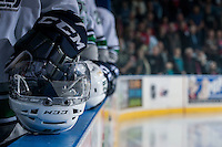 KELOWNA, CANADA - MARCH 18: The Seattle Thunderbirds stand on the bench against the Kelowna Rockets on March 18, 2015 at Prospera Place in Kelowna, British Columbia, Canada.  (Photo by Marissa Baecker/Shoot the Breeze)  *** Local Caption *** Bench; helmets; Seattle Thunderbirds;