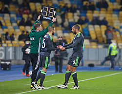 KIEV, UKRAINE - Easter Monday, March 28, 2016: Wales' captain Ashley Williams shakes hands with Ashley 'Jazz' Richards as he is substituted during the International Friendly match against Ukraine at the NSK Olimpiyskyi Stadium. (Pic by David Rawcliffe/Propaganda)