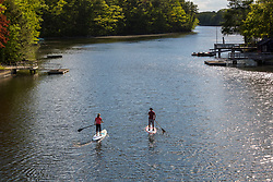 A couple paddleboarding on Chauncey Creek in Kittery, Maine.