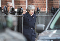 © Licensed to London News Pictures. 30/01/2018. London, UK. Prime Minister Theresa May and her husband Philip May (L) leave Downing Street to travel to China on a three day trade and diplomatic visit.  Photo credit: Peter Macdiarmid/LNP