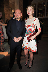 SIR BEN KINGSLEY and ROSAMUND PIKE at the BAFTA Nominees party 2011 held at Asprey, 167 New Bond Street, London on 12th February 2011.