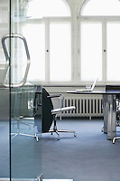 Empty conference room with laptop on table