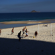 Locals play beach football during the late afternoon sunshine at Sao Conrado beach, Rio de Janeiro,  Brazil. 8th July 2010. Photo Tim Clayton...