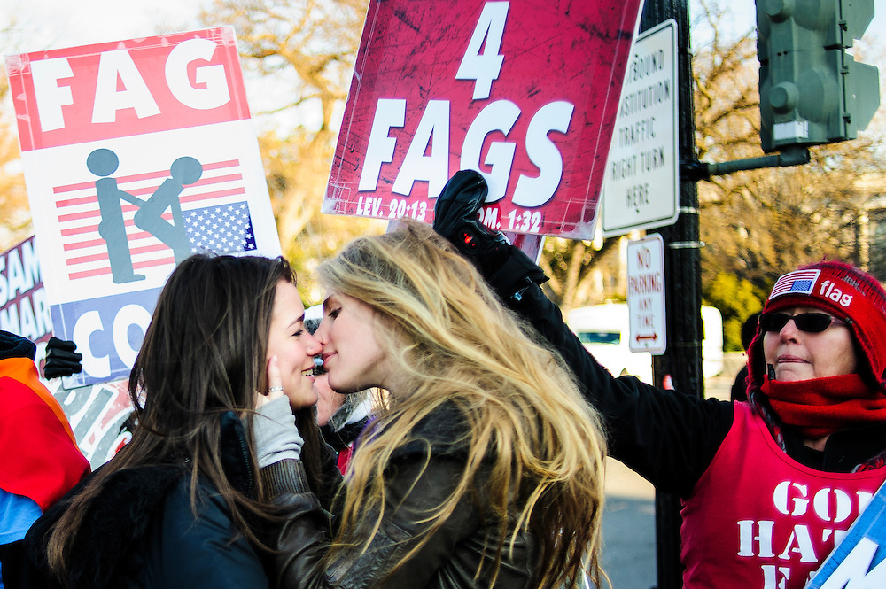 Georgetown University students Hannah Hauer-King 21, and Alexandra Waldon, 20, kiss in front of the Westboro Baptist Church protesters at the Supreme Court in Washington D.C. Activists on both sides of the same sex marriage issue rallied outside of the Court in Washington, D.C. as the Court is to hear arguments on the constitutionality  the 1996 Defense of Marriage Act (DOMA) DOMA defines marriage as only between a man and a woman.