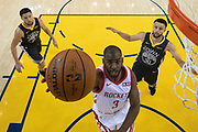 April 30, 2019; Oakland, CA, USA; Houston Rockets guard Chris Paul (3) shoots the basketball against Golden State Warriors guard Klay Thompson (11) and guard Stephen Curry (30) during the second half in game two of the second round of the 2019 NBA Playoffs at Oracle Arena. The Warriors defeated the Rockets 115-109.
