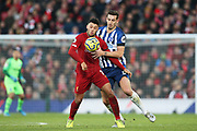 Liverpool midfielder Alex Oxlade-Chamberlain (15) and Brighton and Hove Albion defender Lewis Dunk (5) during the Premier League match between Liverpool and Brighton and Hove Albion at Anfield, Liverpool, England on 30 November 2019.
