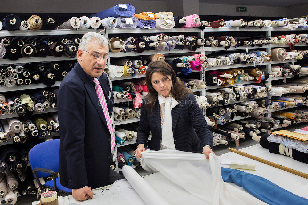 ARZANO, ITALY - 16 January 2014:  Maria Giovanna Paone, Vice President and General Manager of Kiton, checks a fabric at the Ladies division of the Kiton factory in Arzano, Italy, on January 16th 2014.
