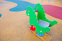 Playground horse with colored rubber flooring